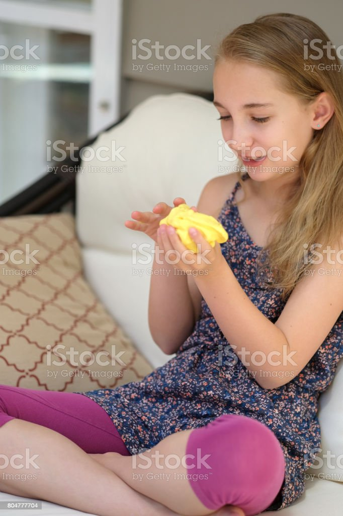 Preteen Girl Plays With Homemade Slime stock photo