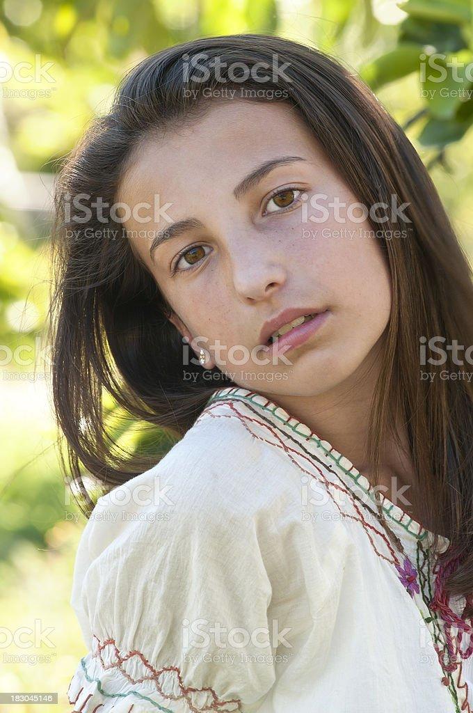 Pre-teen girl posing outdoor - IV royalty-free stock photo