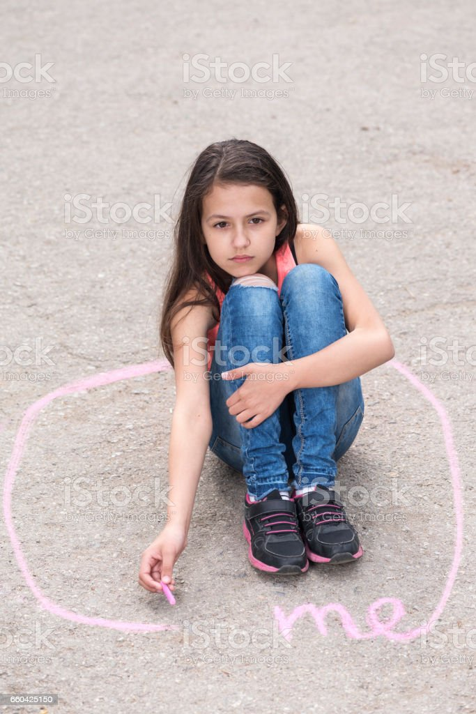 Preteen girl sitting in a circle stock photo