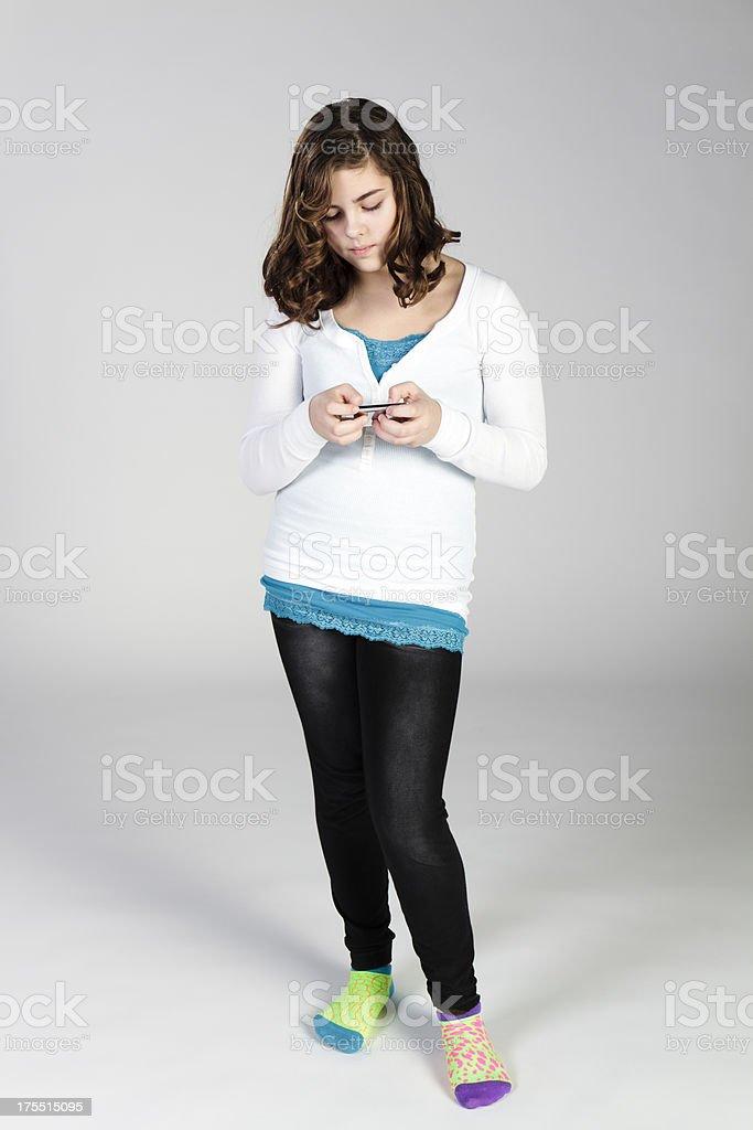 Pre-teen Girl Texts a Message To Her BFF stok fotoğrafı