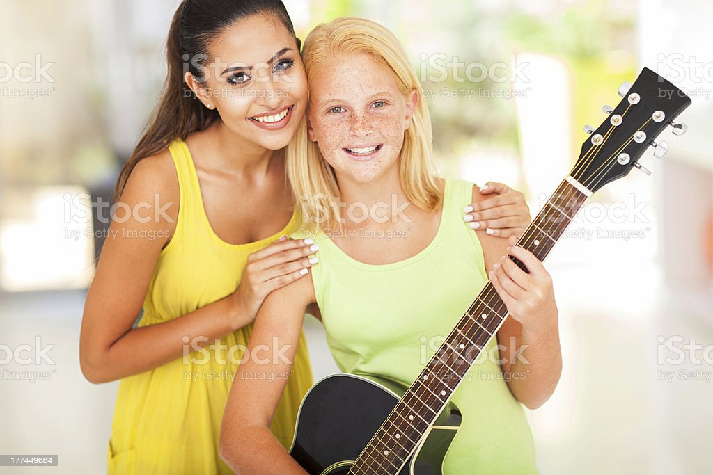 preteen girl with her music teacher royalty-free stock photo