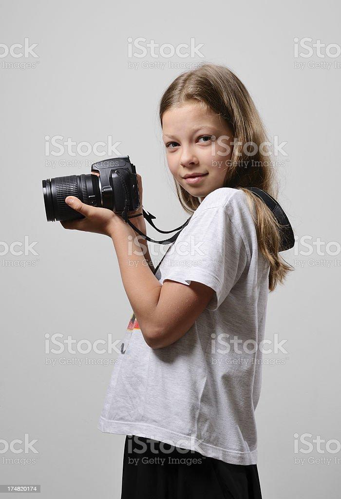 Preteen girl wth the slr camera stock photo