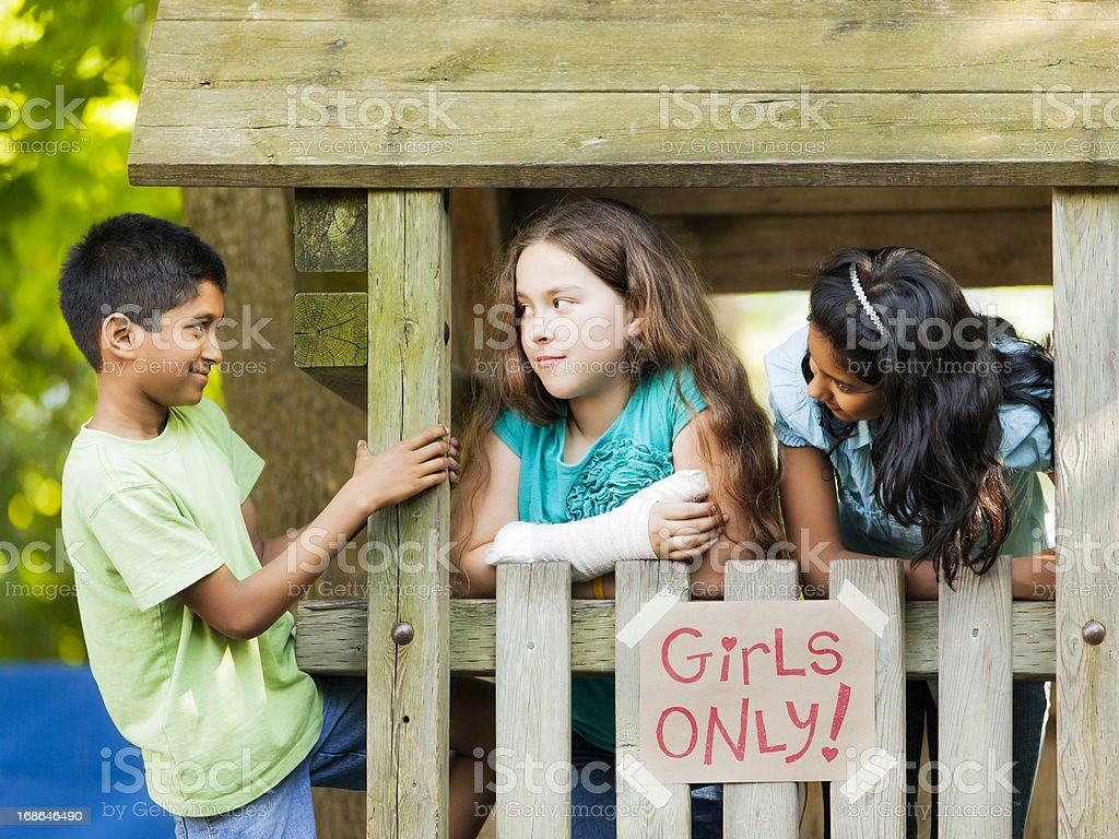 Pre-Teen Girls Hanging Out in Their Clubhouse - Stock image .