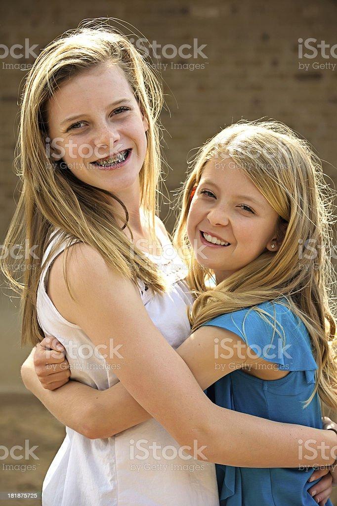 Pre-teen girls hugging royalty-free stock photo
