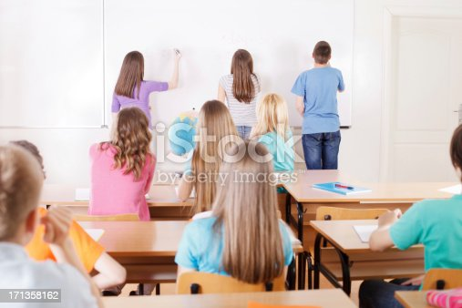157687202 istock photo Preteen pupils in classroom doing maths on whiteboard 171358162