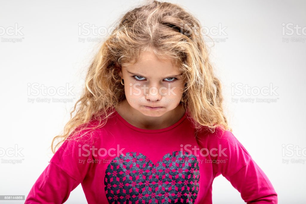 Preteen sulky girl making angry face stock photo