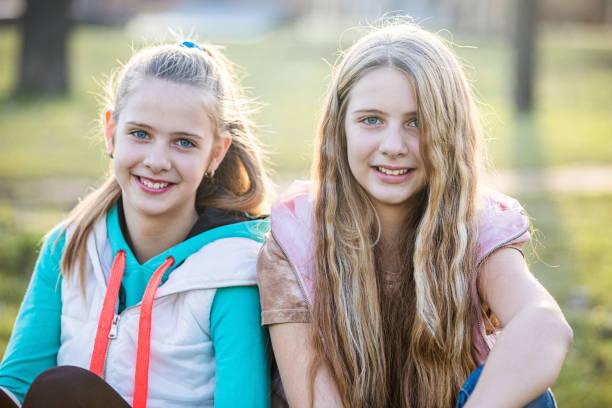 Preteen Twin Girls Outdoor Portrait stock photo