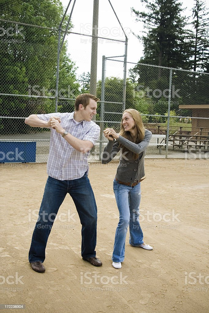 pretend batting, wife looking at husband royalty-free stock photo