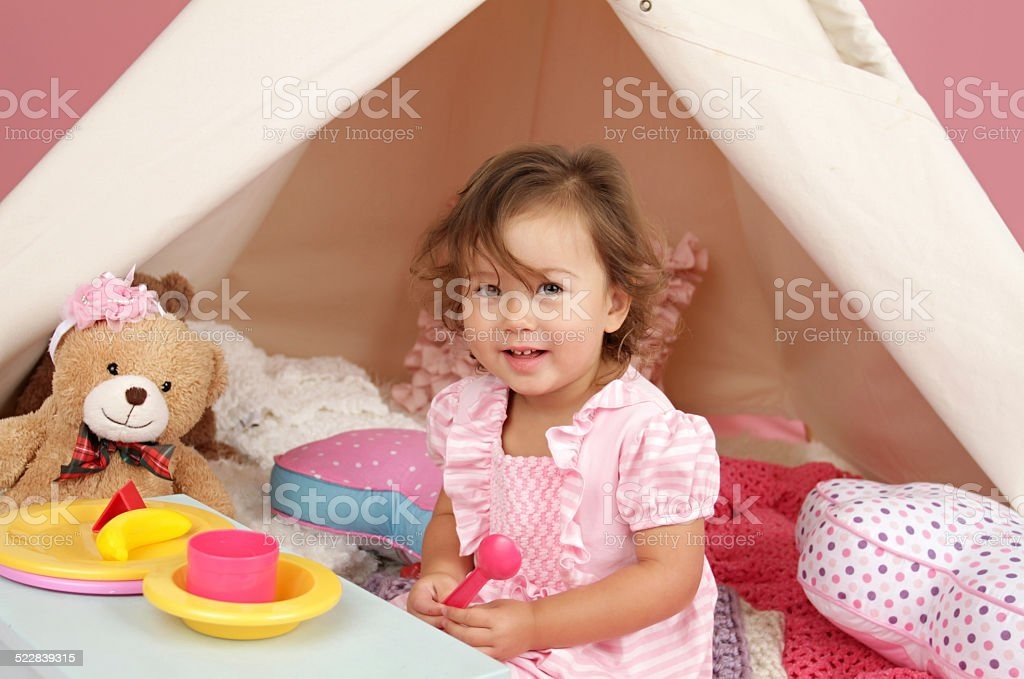 Pretend Play Tea Party at home with a TeePee Tent royalty-free stock photo