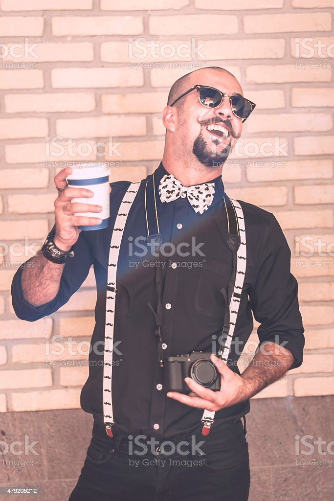 Pretentious hipster having an annoying laughter stock photo