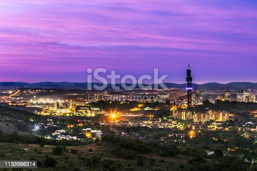 Pretoria cityscape with UNISA, university of south africa and Communication tower at night, sunset cloudscape skies. Pretoria in South Africa is also known as