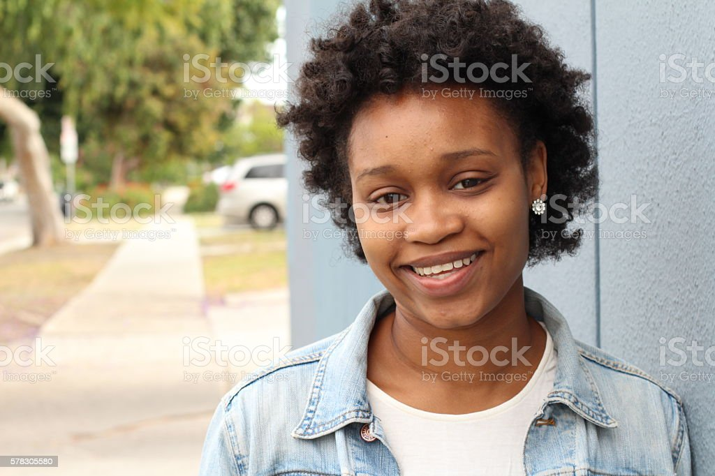 Pretty african american college student on campus stock photo