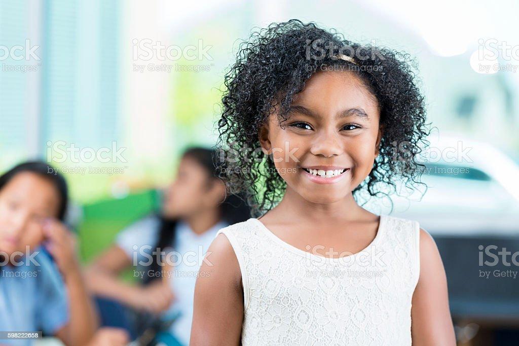 Pretty African American schoolgirl stock photo