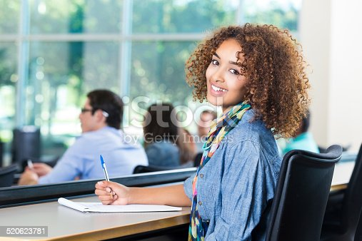 istock Pretty African American student smiling during lecture in college classroom 520623781