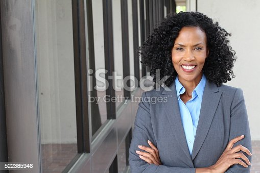 istock Pretty African american woman at work 522385946