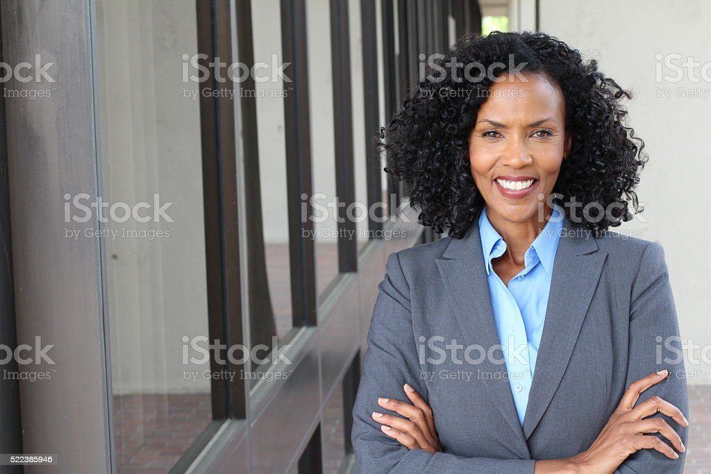 Pretty African american woman at work stock photo