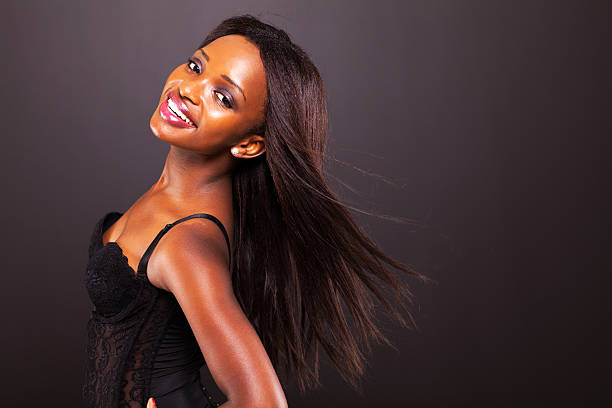 pretty african american woman with long hair stock photo