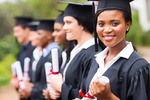 pretty african female college graduate at graduation stock photo