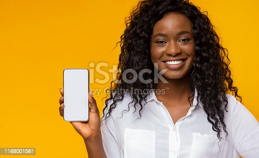 614011750istockphoto Pretty afro girl showing brand new smartphone 1168001561
