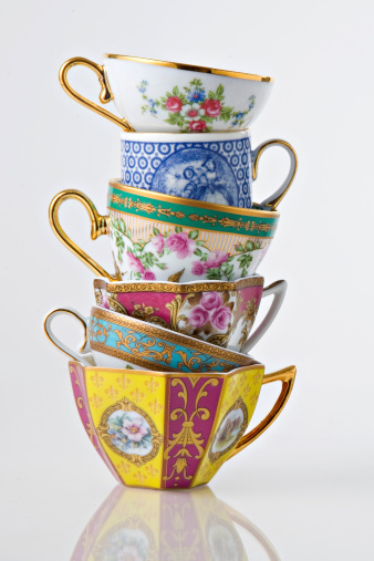 Pretty Antique Tea and coffee cup tower on white background