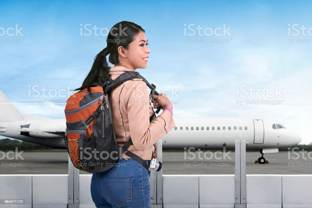 Pretty asian tourist going traveling by plane - Royalty-free Adult Stock Photo
