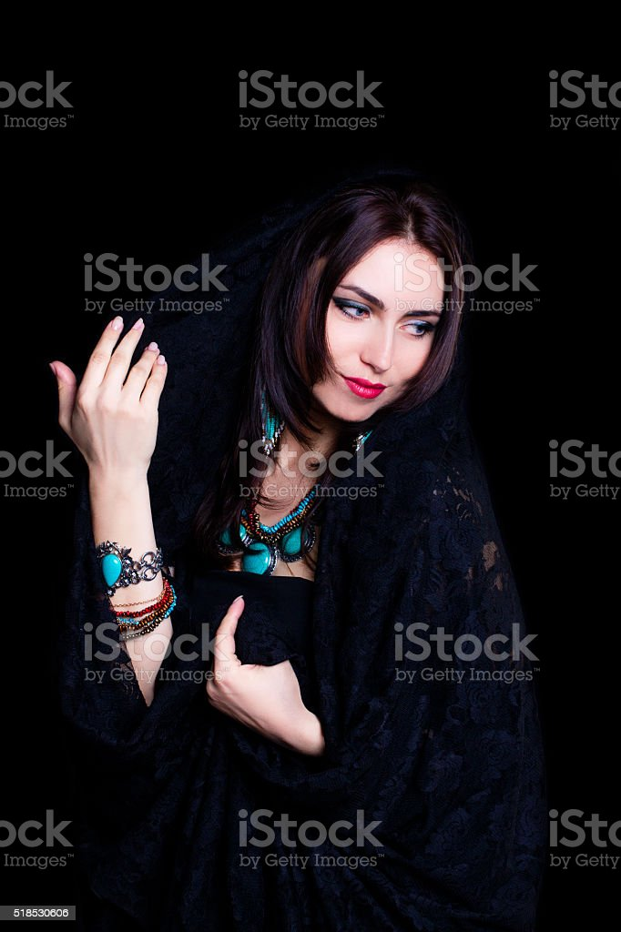 Pretty oriental woman in abaya on black background stock photo