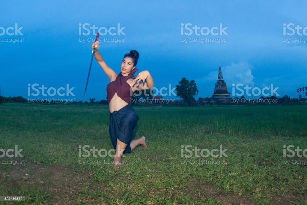 Pretty Asian Woman Posing In Thai Ancient Warrior And Hold A Dual