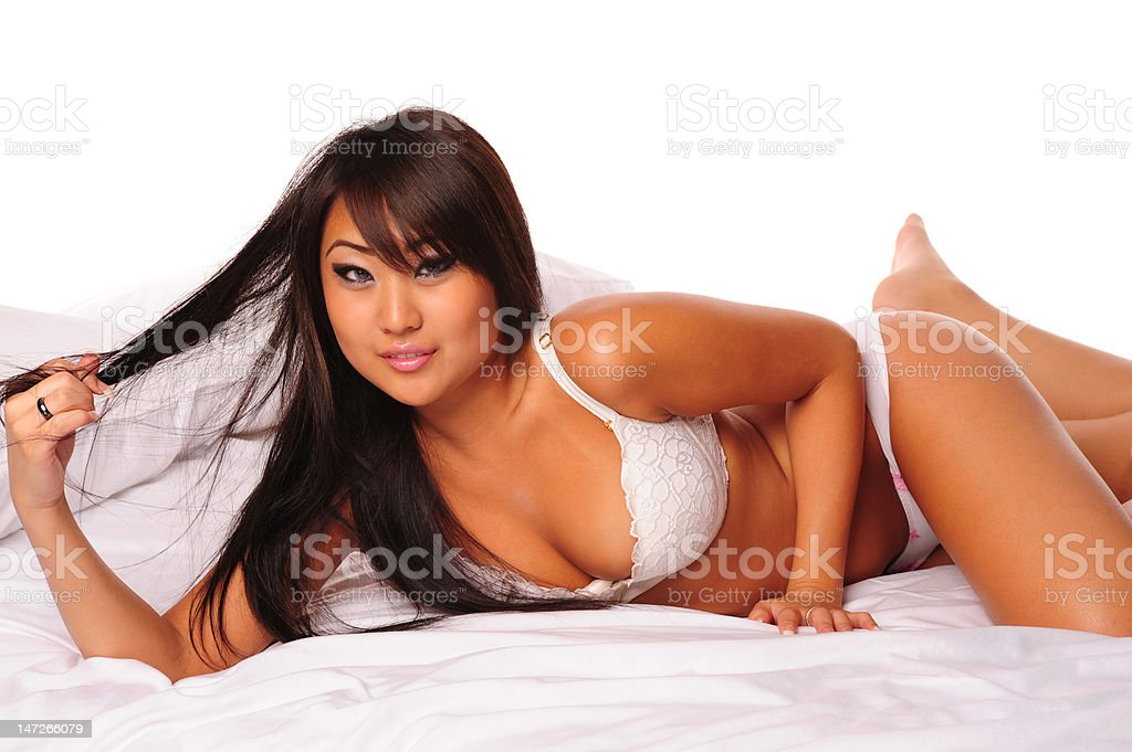 Pretty asian woman pulling hair stock photo