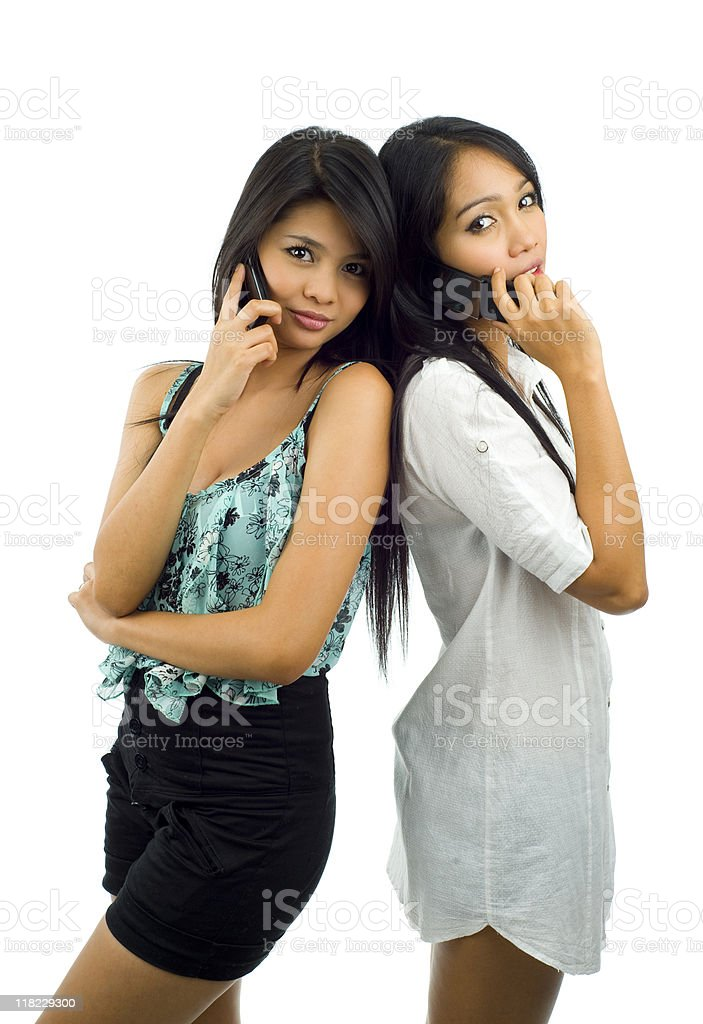 pretty asians with mobile phones royalty-free stock photo