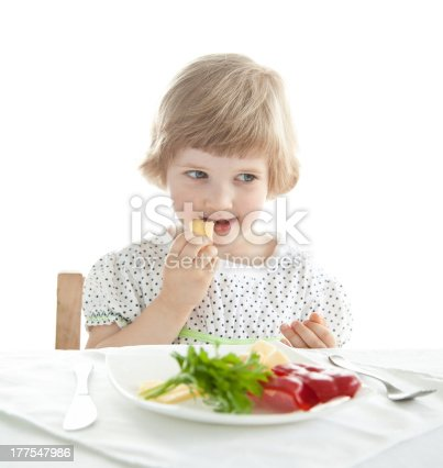 istock Pretty baby girl eating 177547986