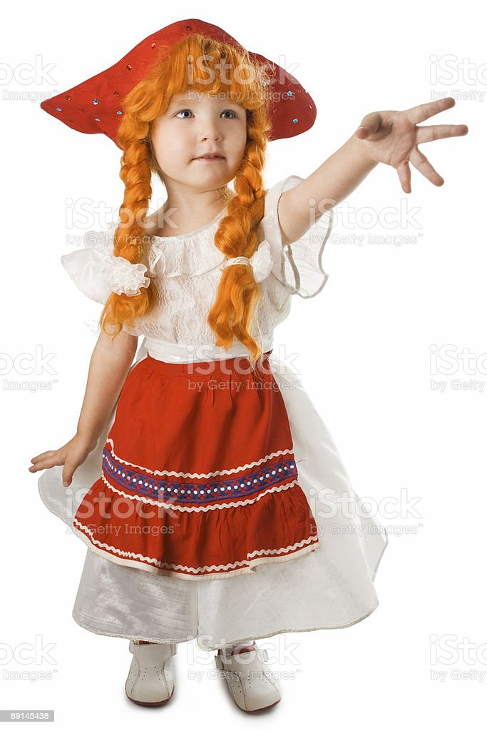 pretty baby in festival dress red hat and plait royalty-free stock photo