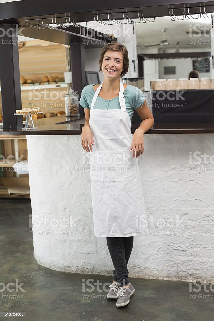 Pretty barista smiling at camera stock photo