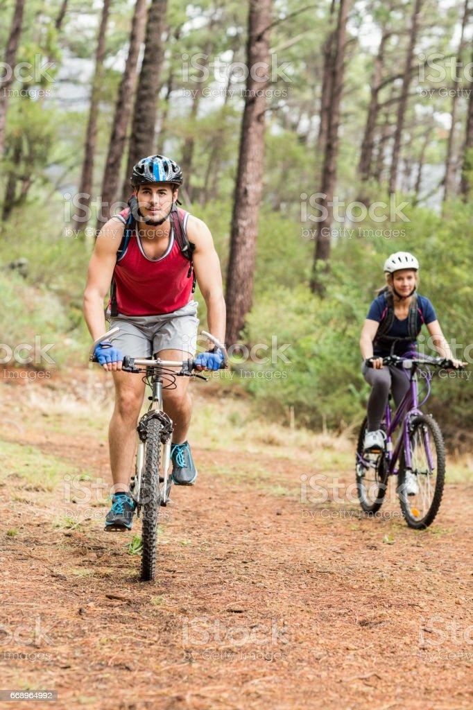 Pretty biker couple biking foto stock royalty-free