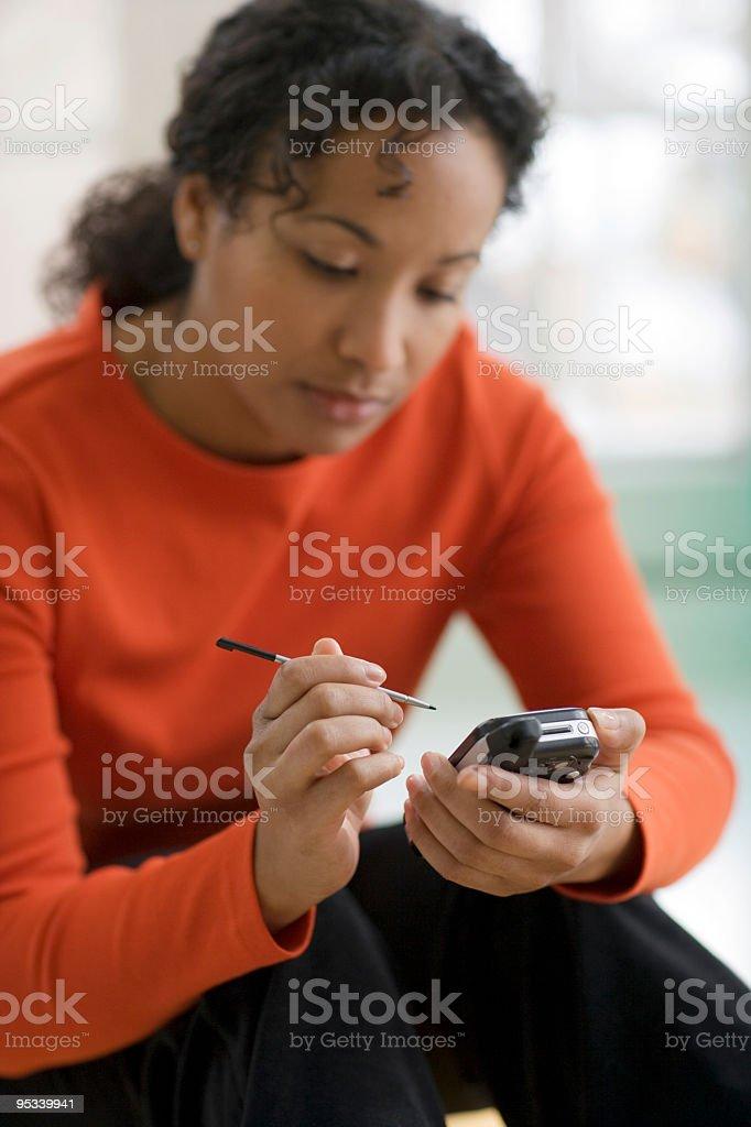 Pretty black woman on PDA royalty-free stock photo