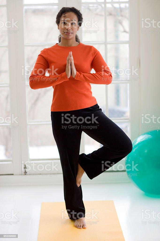 Pretty black woman practicing yoga royalty-free stock photo