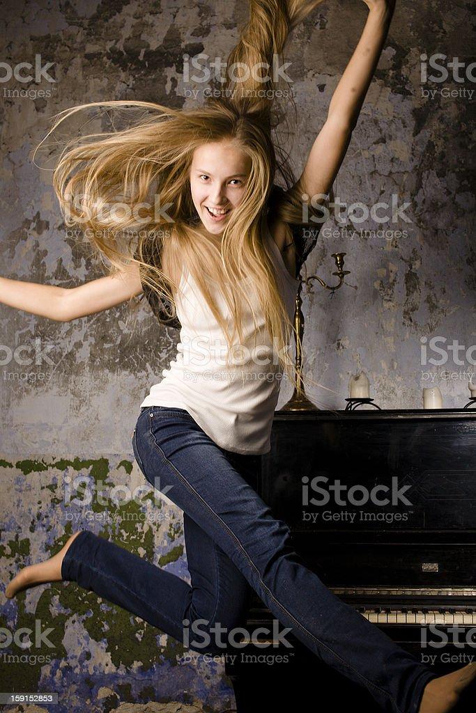pretty blond girl at piano stock photo