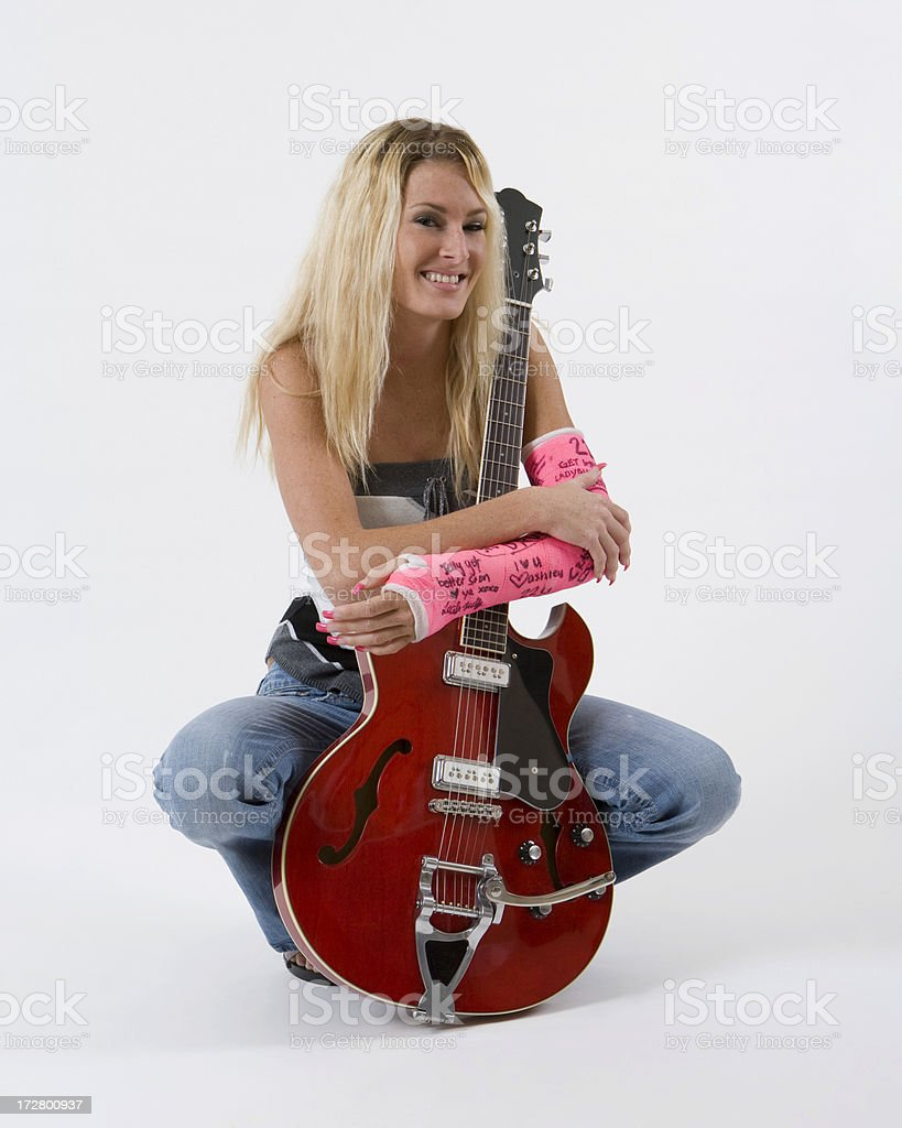 pretty blond girl holding red guitar royalty-free stock photo