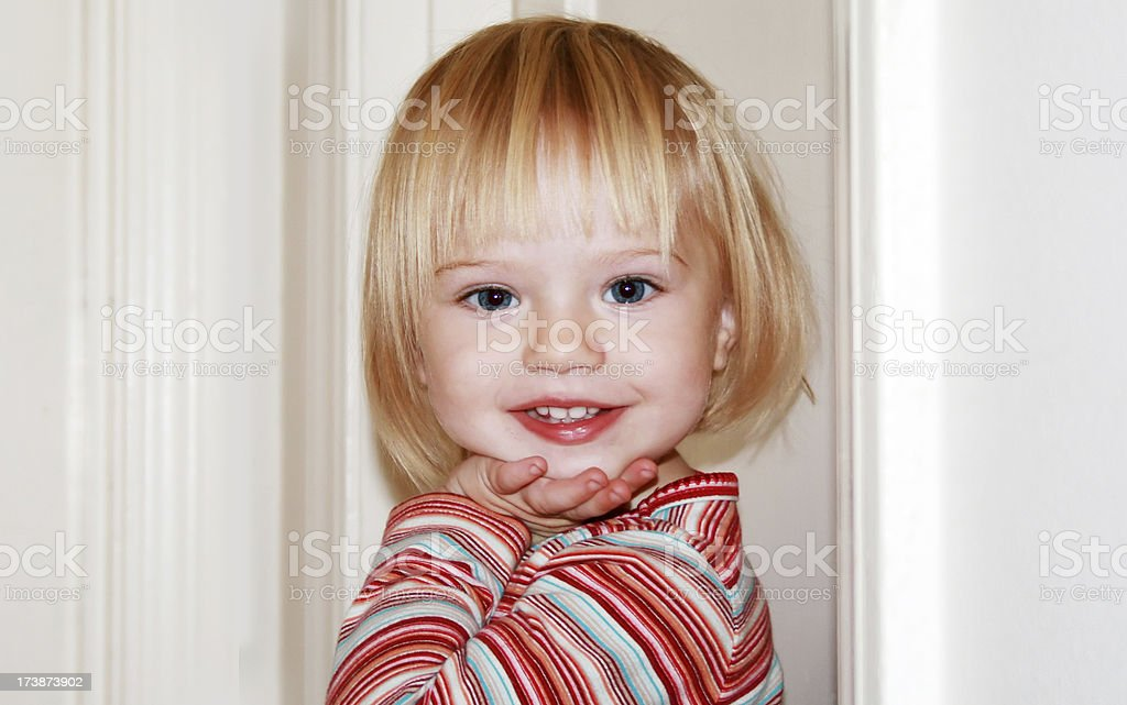 Pretty Blond Girl Posing for the Camera royalty-free stock photo