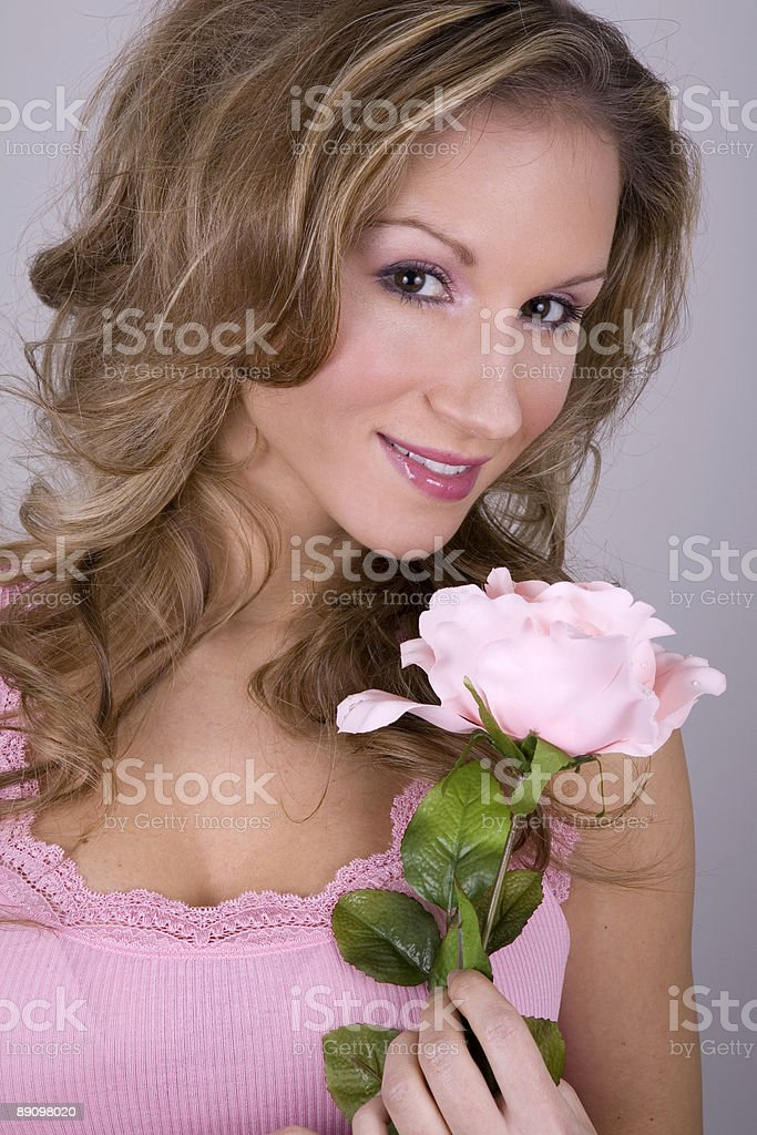 pretty blond holing pink rose royalty-free stock photo