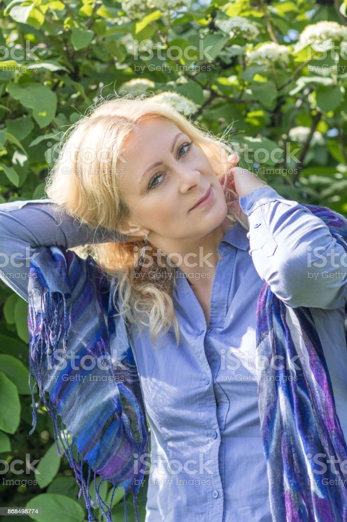 Pretty blond in the city park in spring royalty-free stock photo