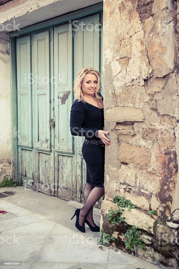 Pretty Blond Lady in the old town (mediterrainean architecture) stock photo