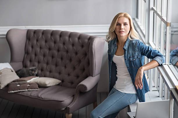Pretty blond woman leaning on windowsill picture id615515878?b=1&k=6&m=615515878&s=612x612&w=0&h=gggbkjbuu05gdebucuss0ov238qcuwi6g0evph5qgyo=