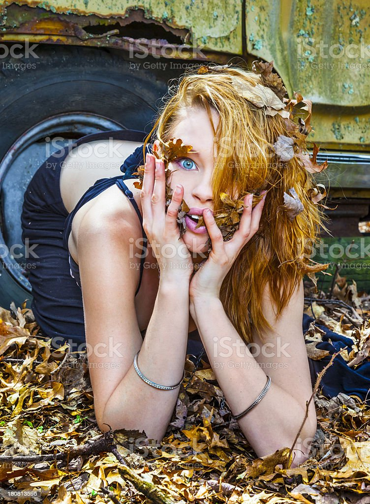 Pretty Blond Woman Playing in Leaves stock photo
