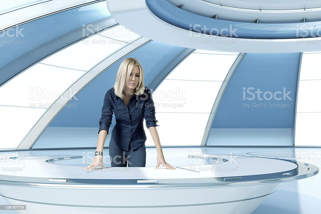 Pretty blonde boss by the office table stock photo