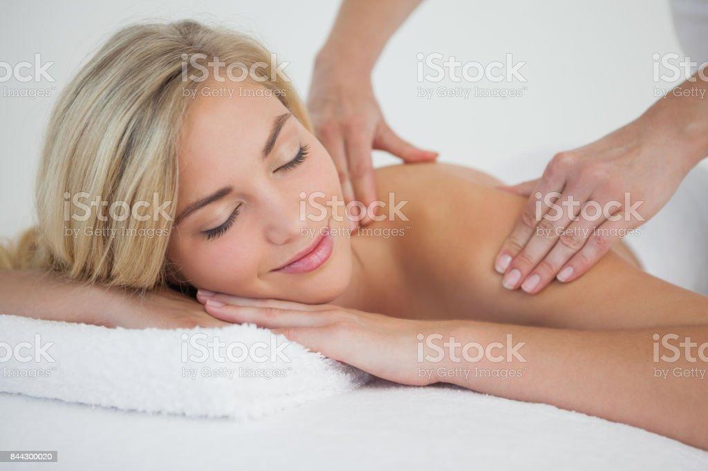 Pretty blonde enjoying a massage stock photo