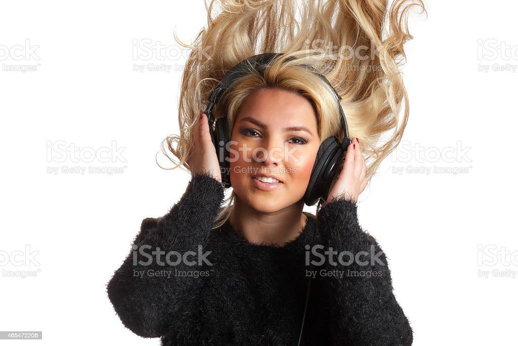 Pretty Blonde Flinging Hair Listening Headphones Isolated Background stock photo