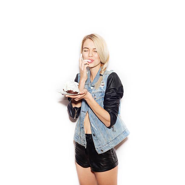 Pretty blonde girl  eating chocolate Cake stock photo