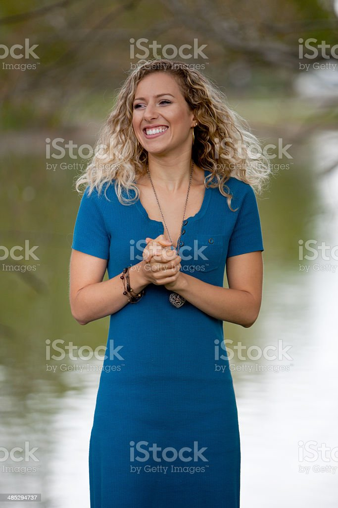 Pretty Blonde Girl in a Blue Dress stock photo