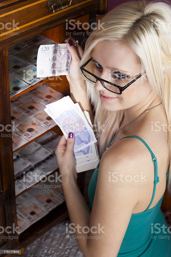 Pretty Blonde Hoarding Money royalty-free stock photo