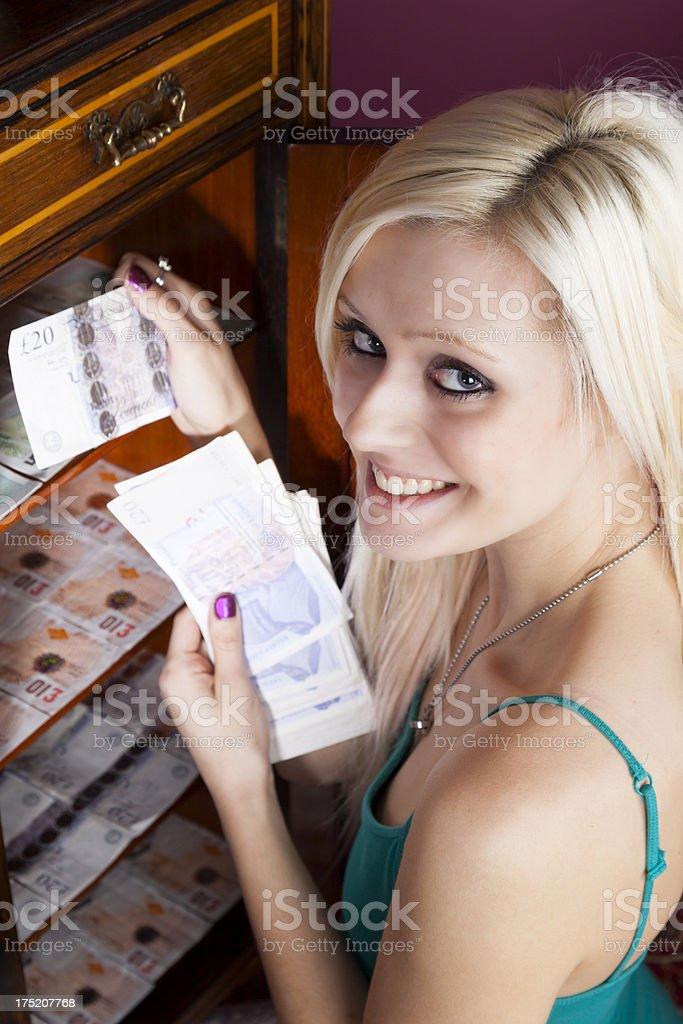 Pretty Blonde Hoarding Money stock photo